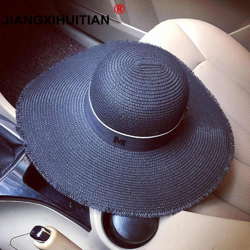 2018 nuevo Hepburn viento negro blanco rayas Bowknot verano M logo sol  sombrero mujer hermosa paja b6f78fa800fb