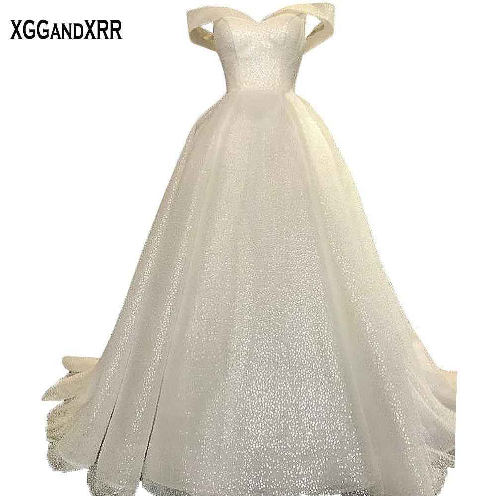 Incroyable robe de bal robe de mariée 2018 robe de mariée de luxe robe de mariée brillant tissu chérie hors épaule grande taille Style dubaï
