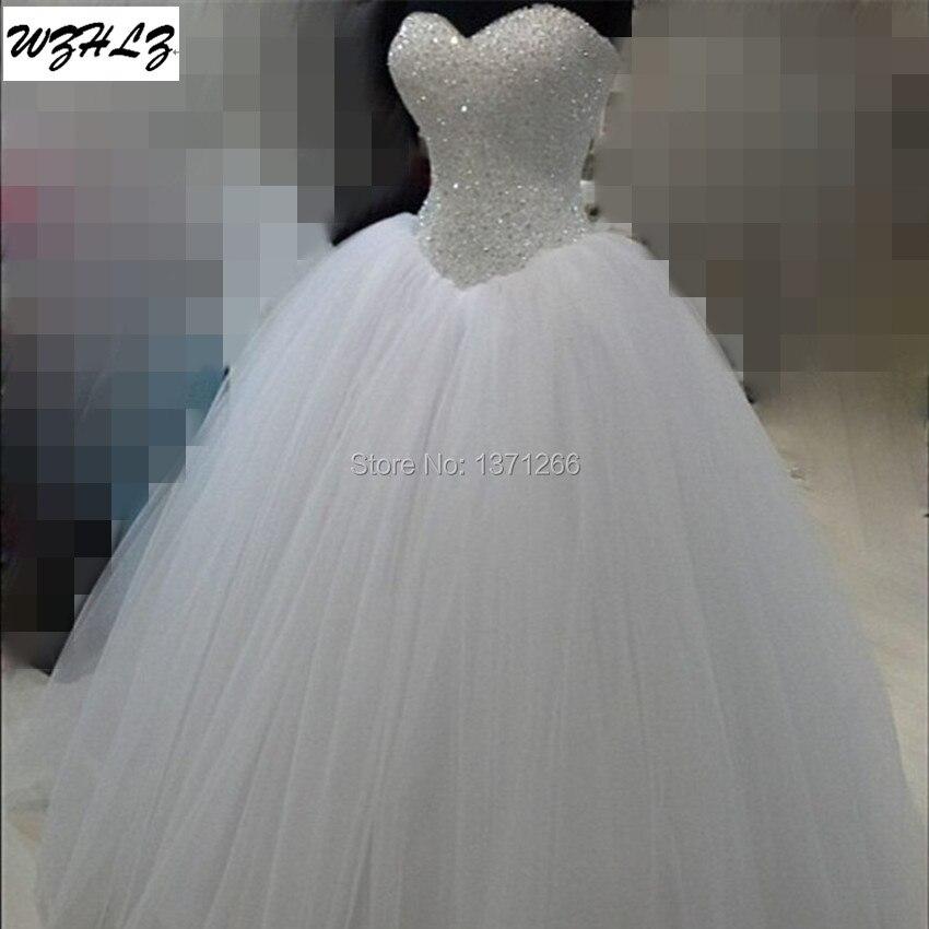 Luxury white heavy beaded princess wedding dress 2017 real for Heavy beaded wedding dresses