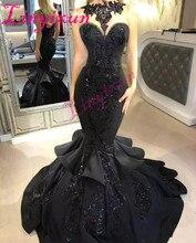 Oszałamiająca czarna syrenka długie sukienki balowe 2020 Sexy zroszony Appliqued kaskadowe potargane sąd pociąg Backless formalna suknia wieczorowa