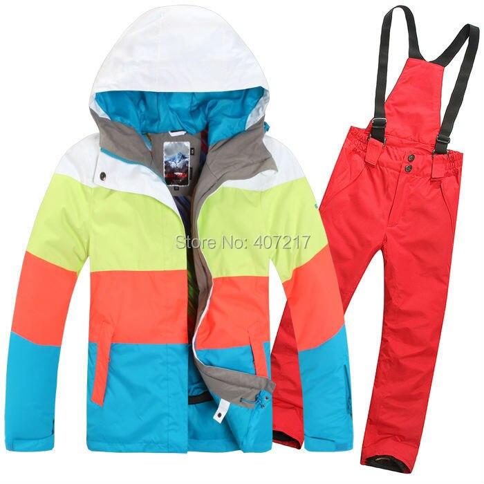 Prix pour 2015 Nouveau femmes mesdames combinaison de ski snowboard vêtements de ski couleur bandes correspondant veste + pantalon rouge étanche respirant 7 couleurs