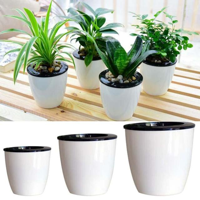 New self watering pot flowerpot planter basket home garden new self watering pot flowerpot planter basket home garden convenience decor diy workwithnaturefo