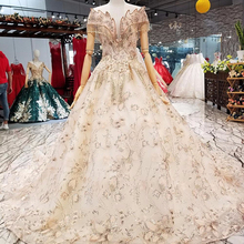New Vintage Sexy Boat Neck Evening Dresses Long Sleeve Appliques Pearls  Fashion Tulle Bridal Gown Alibaba b86613c73c3e