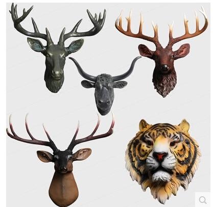 Animal head. European household metope hangs. Ornament on the wall Animal head. European household metope hangs. Ornament on the wall