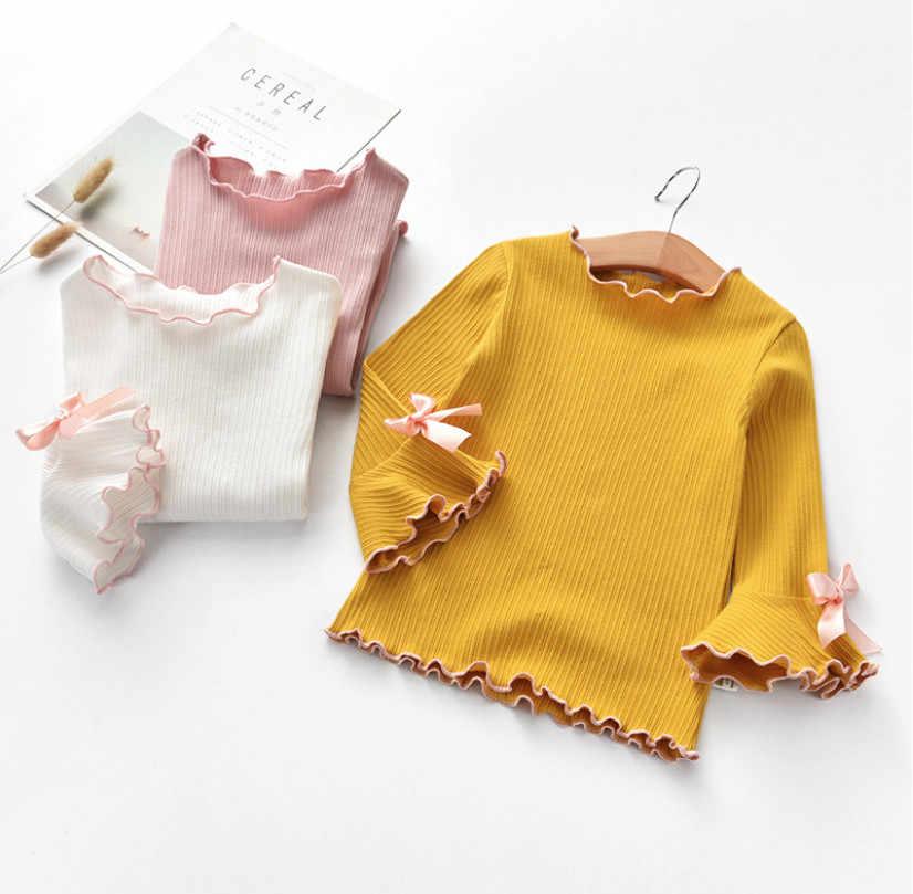 ฤดูใบไม้ผลิใหม่ฤดูใบไม้ร่วงสาวฤดูหนาวเสื้อเด็กสีขาวสีชมพูแขนยาวลูกไม้โบว์เด็กทารกเสื้อ t เสื้อเด็กเสื้อผ้าของขวัญ