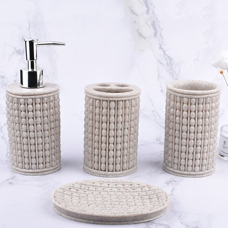 Modern creative resin sandstone hand-polished four-piece bathroom accessories lotion bottle& soap dish & toothbrush holder & cup image