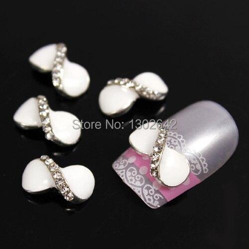 D75 10pcs/lot Fashion Cross Bow Tie Rhinestone Alloy Nail Art Finger Tips Nail Accessories Free Shipping