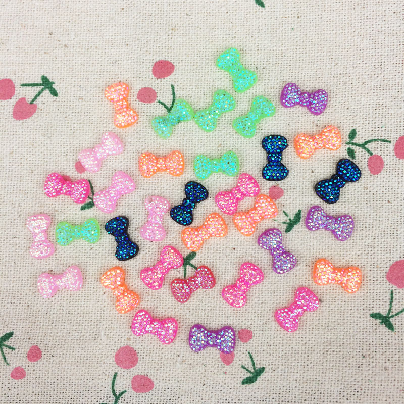 200 Pieces Flat Back Resin Cabochon Kawaii DIY 3D Nail Art Bows AB Color Manicure Salon Supplies Bow Tie Nail Art Tips :7*12mm