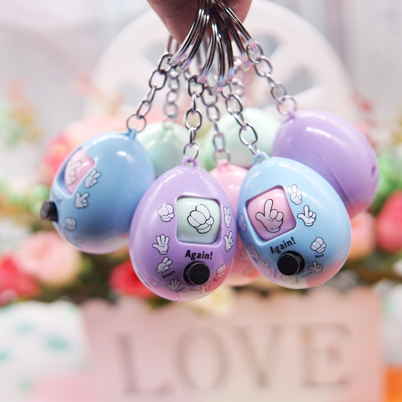 Funny Family Games Button Press Stone Scissors Guessing Toy Plastic Round Egg Key Chain Tossed Eggs Guessing Toy For Kids