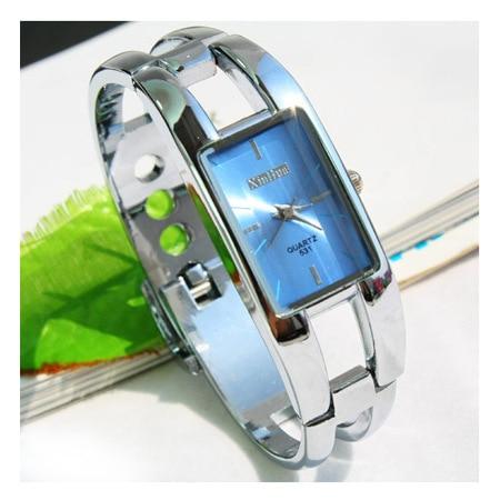 цена  Hot Fashion Luxury Silver Bracelet Watch Women Clocks Quartz Watch Ladies Hour Montre Femme relogio feminino relojes mujer 2016  онлайн в 2017 году