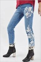 2017 קיץ חם נשים ג 'ינס חדש מקרית מכנסיים ג' ינס עם ציצית רקומה דקורטיבי פרחי צבע טהור ג 'ינס מותן גבוה