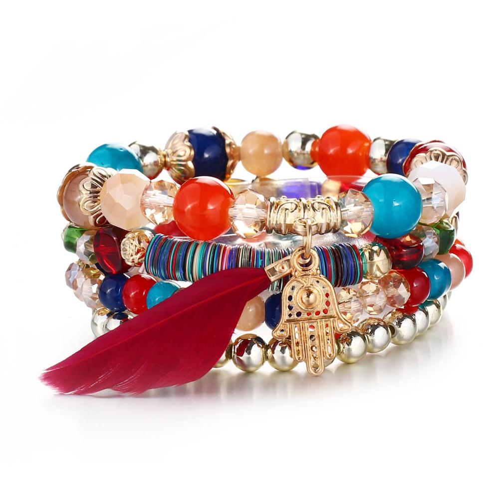 Pearl turquoise pearl bracelet with feathered charms with crystals