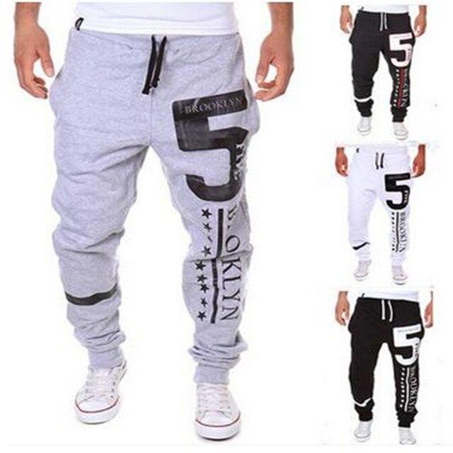 Новый 2016 весной и осенью период мужская мода джокер штаны числа 5 печать свободного покроя брюки ноги брюки