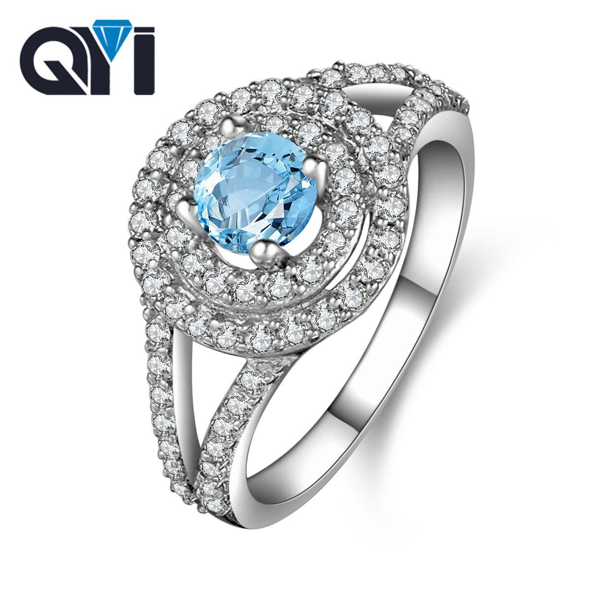 QYI pierres précieuses 925 en argent Sterling anneaux de luxe femmes 0.8 ct coupe ronde Halo fiançailles bleu ciel bague topaze bijoux fins en gros