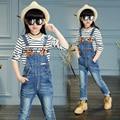 2017 de primavera y otoño de la moda clásica pantalones vaqueros de los niños niñas 4-13solid color lavado estándar de la correa de cuero hebilla de los pantalones de la correa