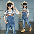 2017 spring and autumn fashion classic children's jeans girls 4-13solid color washed leather standard belt buckle strap trousers