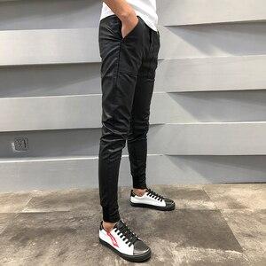 Image 3 - ¡Novedad! pantalones de cuero PU para hombre, pantalones de chándal informales ajustados para hombre, pantalones bombachos Hip Hop con cordón, pantalones bombachos para hombre 40