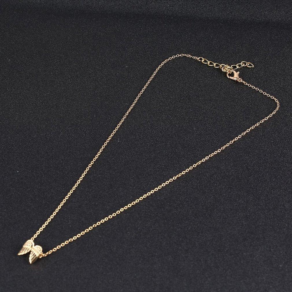 ef5f584a00ff3 فريد ريشة الجناح مثلث يونيكورن شكل سلاسل الترقوة قلادة قصيرة Chocker عيد  الميلاد هدايا مجوهرات قلادة مع بطاقة
