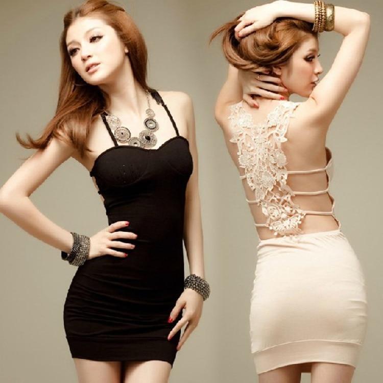 Sexy plus size model girl in trendy dress sitting