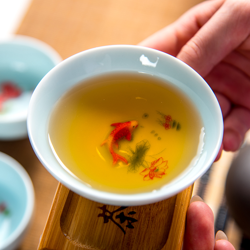 Купить с кэшбэком Chinese Tea Cup Porcelain Celadon Fish Teacup Set Teapot Drinkware Ceramic China Kung Fu Tea Set Ceramic cup Chinese gift D042