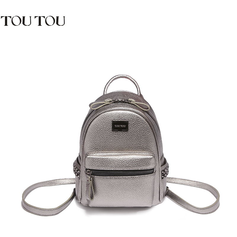 TOUTOU backpack Rivet women bag joker fashion and personality The high quality large capacity multi-functional bag Free shipping high quality free shipping bag for the