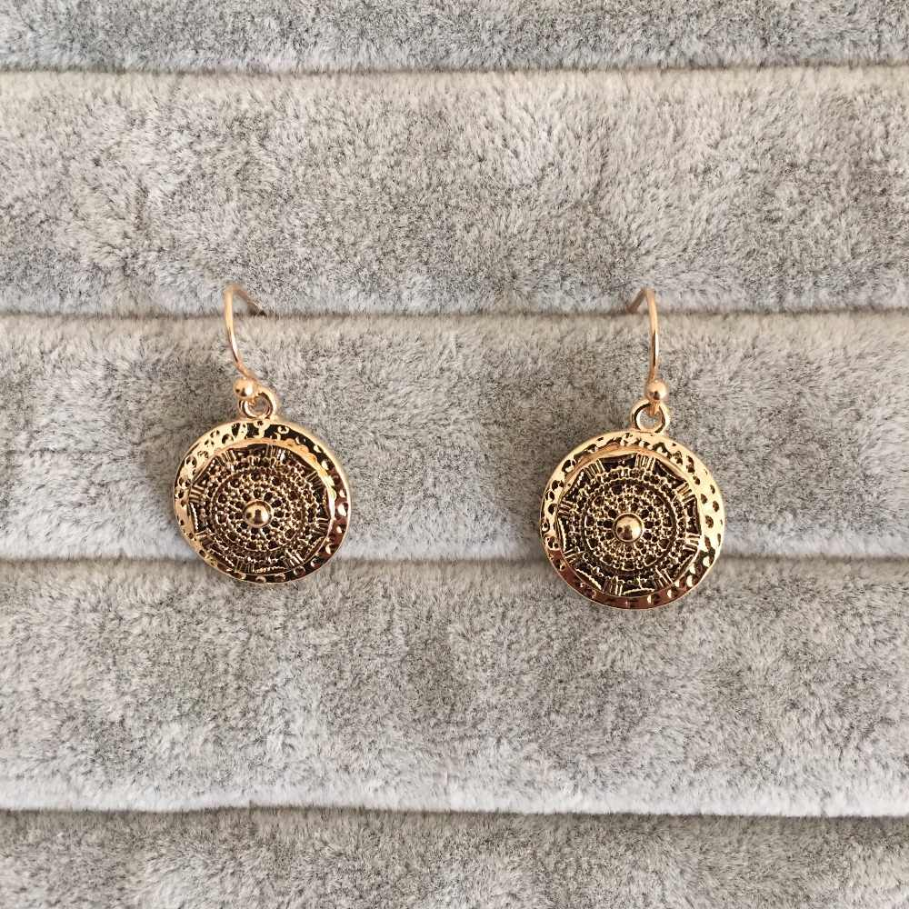 Antic gold round disc earring