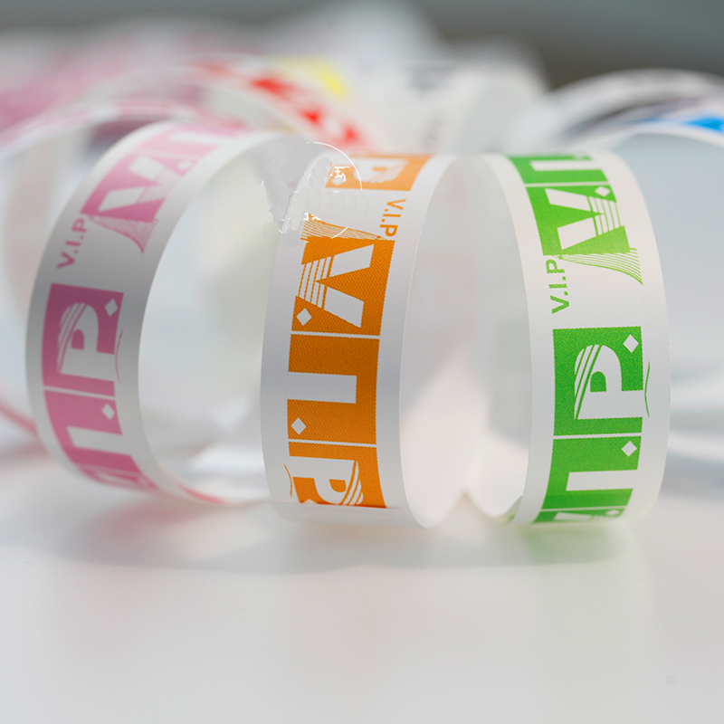 100 Pieces Waterproof Disposable Pvc Paper Band Toy For Events Swimming Plain Color Cheap Synthetic Paper Wristband Toy