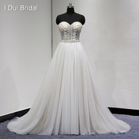 Luxury Beaded Wedding Dress with Champagne Lining Pearl Crystal Rhinestone Sweetheart A line Real Photo High Quality