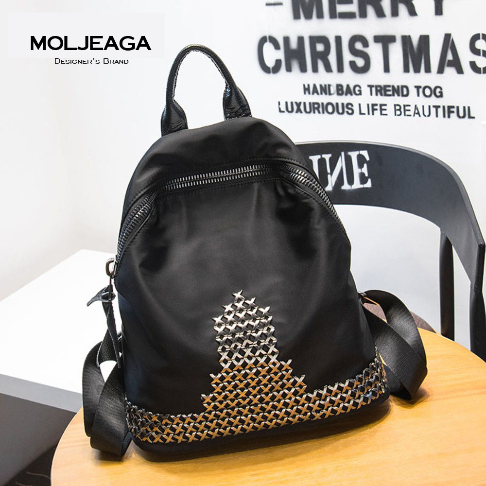 MOLJEAGA High Quality Nylon Women Backpack Fashion Girls School Bag Travel Bag, with Genuine Leather Shoulder Straps Rivet bags