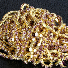 SS6,8,10,12 10m Low-Price Light Amethyst crystal rhinestone cupchain golden setting trimming for woment clothing decoration