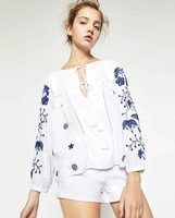 VogaIn 2016ss Women New White Blue Flowers Embroidered Shirts Top Round Neck With Fringed Self Tie Long Sleeved Blouse