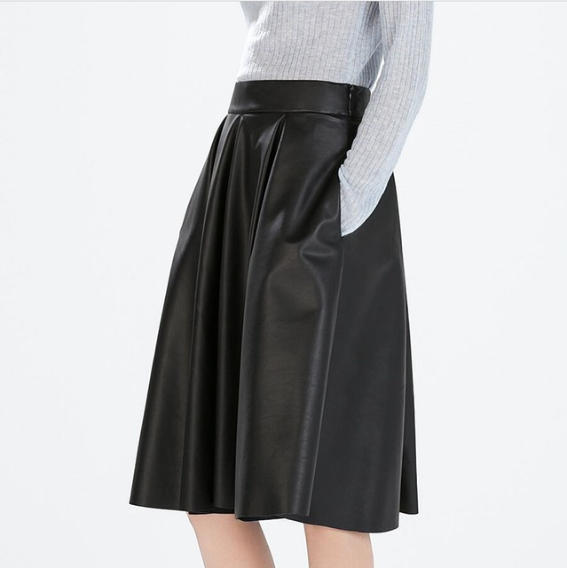 c25a5be3170 Manu 2015 Women High Waist Faux Leather Skirt Knee-length Pleated A-line PU  Skirts Female 7XL Plus Size Women Midi Skater Skirt
