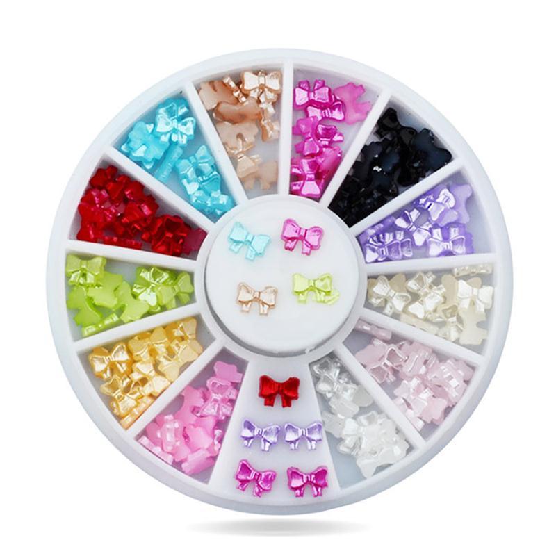 DIY joyería de uñas al por mayor apliques de arco de perlas pegatinas de uñas 12 color / caja