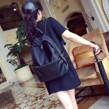 Oxford fabric + leather-based Backpacks   Korean rivet tide leisure journey backpack waterproof canvas bag England BB622