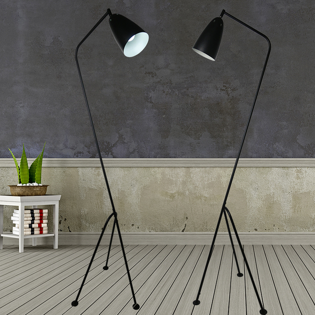 Mediterranean tripod floor lamp lights the long arm of the Nordic ...