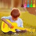 2016 venta caliente 4 cuerdas ukulele guitarra de juguete de plástico para niños musical toys educational toys