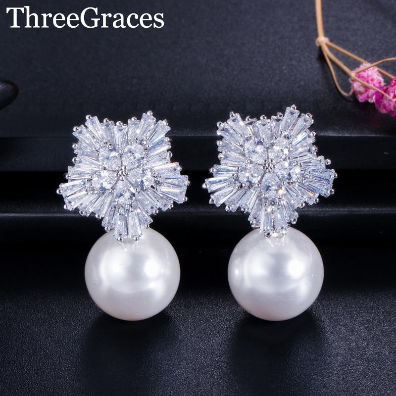ThreeGraces Famoso Diseñador de Joyería Sparkling Snow Flower Cubic Zirconia Crystal Setting Big Pearl Stud Pendientes para Las Mujeres ER020