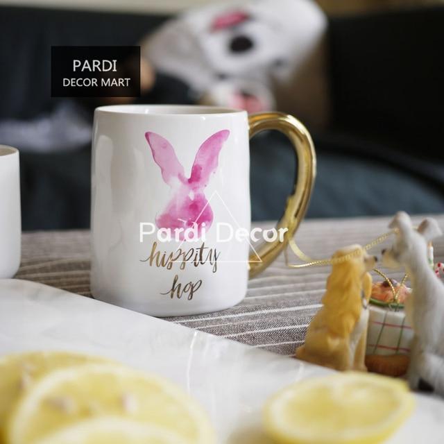 hand irregular coffee mug golden handle rabbit mug can be put into