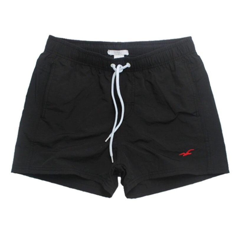 Malla forrada hombres natación pantalones cortos Nylon secado rápido traje de baño hombres corto Surf natación troncos playa ocio deporte ropa traje de baño calzoncillos hombre