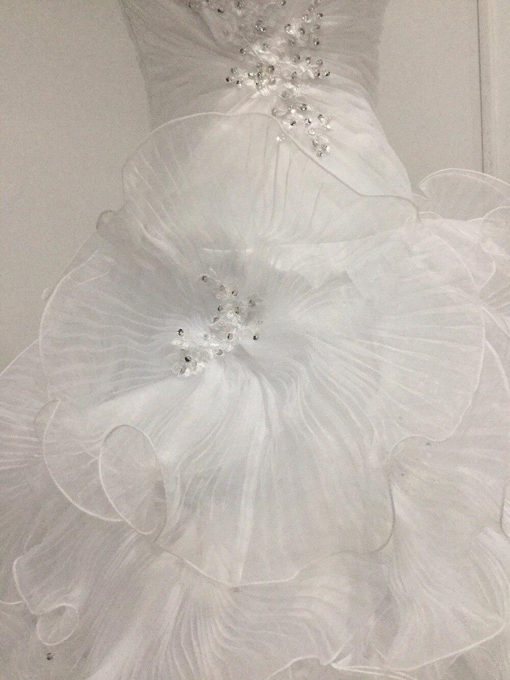Senza spalline Una Linea pieghe increspature big floreale fogli organza  bianco abito da sposa con applicazioni di perline abito da sposa in Senza  spalline ... 31fef79ec74