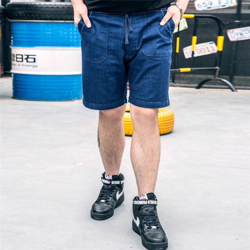 bb07730f58f Click here to Buy Now!! Marée marque de grande taille Hommes stretch Cinq pantalon  grande taille Lâche pantalon denim ...