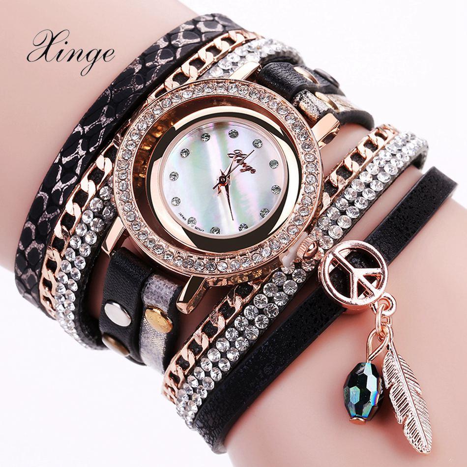 Prix pour Xinge Femmes Marque De Luxe Rose En Cuir Montre Quartz Femmes Robe Bracelet Montre Cadeau Horloge De Mode D'affaires Dames Sport Montre