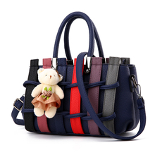 Size: 27 * 17 * 12cm Free shipping 2017 new multi-colored knitting women's handbag. Fashion Bear Strap shoulder bag.