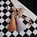 Hot selling Colorful Key Chain Bag AccessoriesIce Silk Tassel With Hollow Bell Pompom Car Keychain Handbag Key Ring For Women