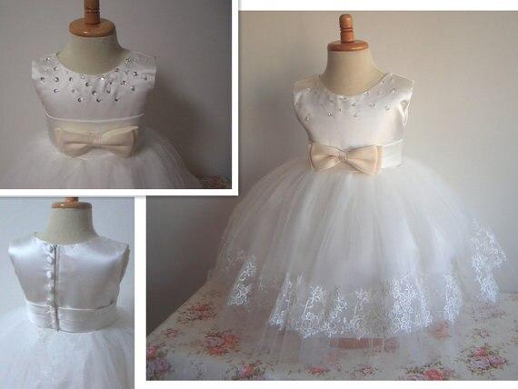b57de0a7a Venta caliente Elegante Vestido de Novia A line Glitz Rebordear Satinado  Precioso Arco Niños Vestido De Partido de la Muchacha de Flor Vestidos de  Bautizo ...