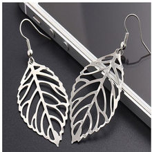 Popular fashion jewelry wholesale hollow metal leaf gold silver long paragraph statement pendant earrings female models