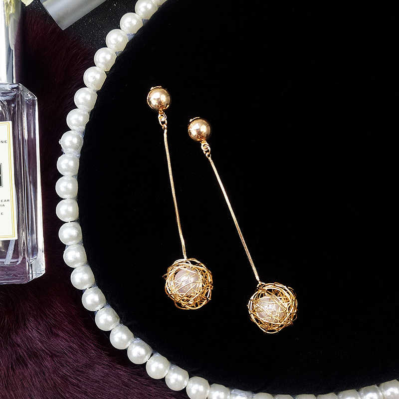Hollow gold skein pearl dangle earrings female  temperament long pendant personality exaggerated earrings drop shipping