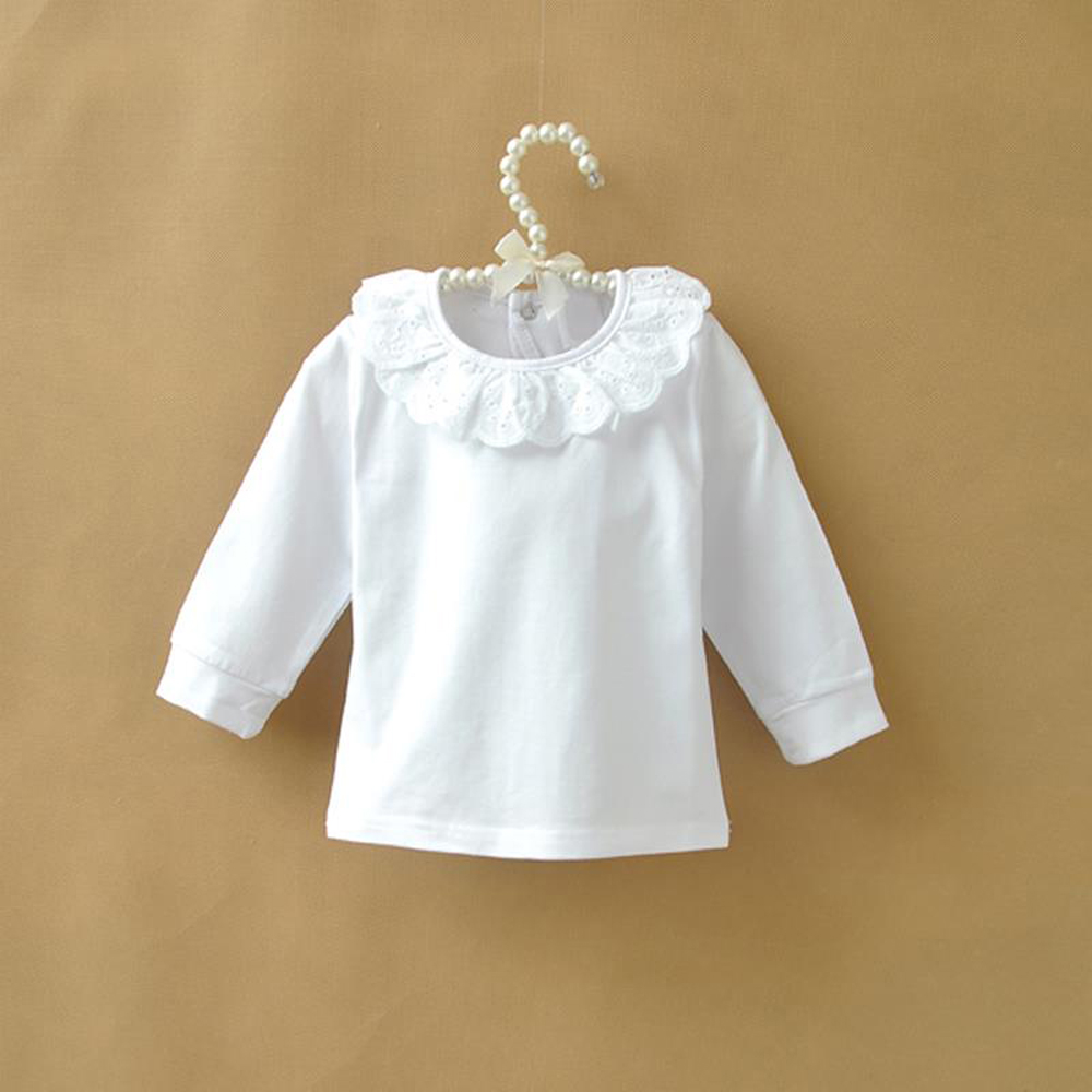 The shirt is long sleeve navy and white gingham checked by Baby Gap. It is a size months. Has a chest pocket with the the Baby Gap teddy bear embroidered on it.