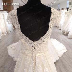 Image 4 - Boné manga v decote vestido de casamento com pérola de luxo frisado delicado laço nupcial vestido de alta qualidade fábrica feito sob encomenda