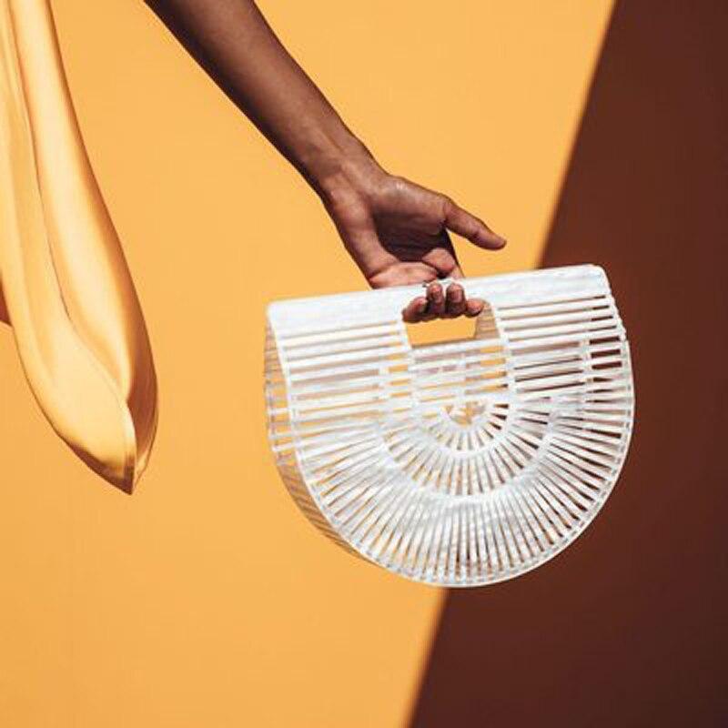 купить Brand Europe Amber Summer Half Round Moon Ark Beach Bag Hollow Out Handbag Basket Plastic Bags Defected Bags Sale On Clearance онлайн